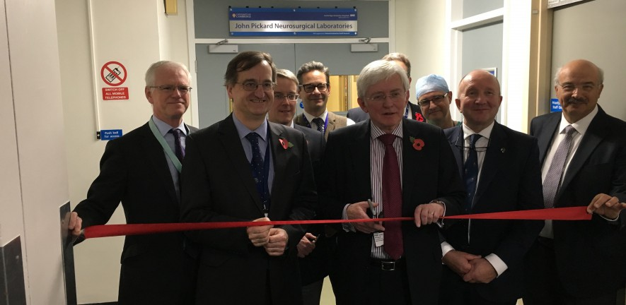 Photo of the HOD, the Regius and other local dignitaries cutting a red ribbon, opening the new JCB laboratory