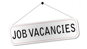 "Illustration of a door sign with the words ""Job Vacancies"" on it."
